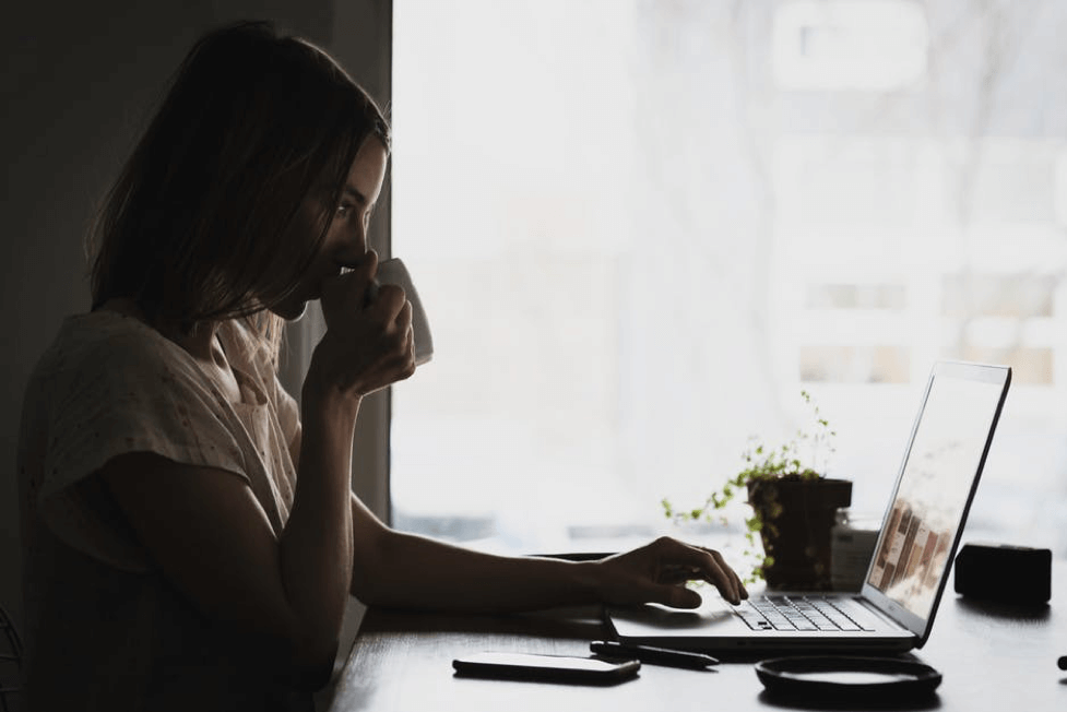 woman with computer and cup of coffee
