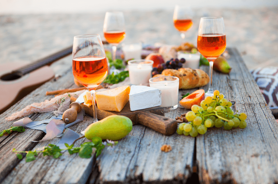 wine and cheese pairings on picnic table