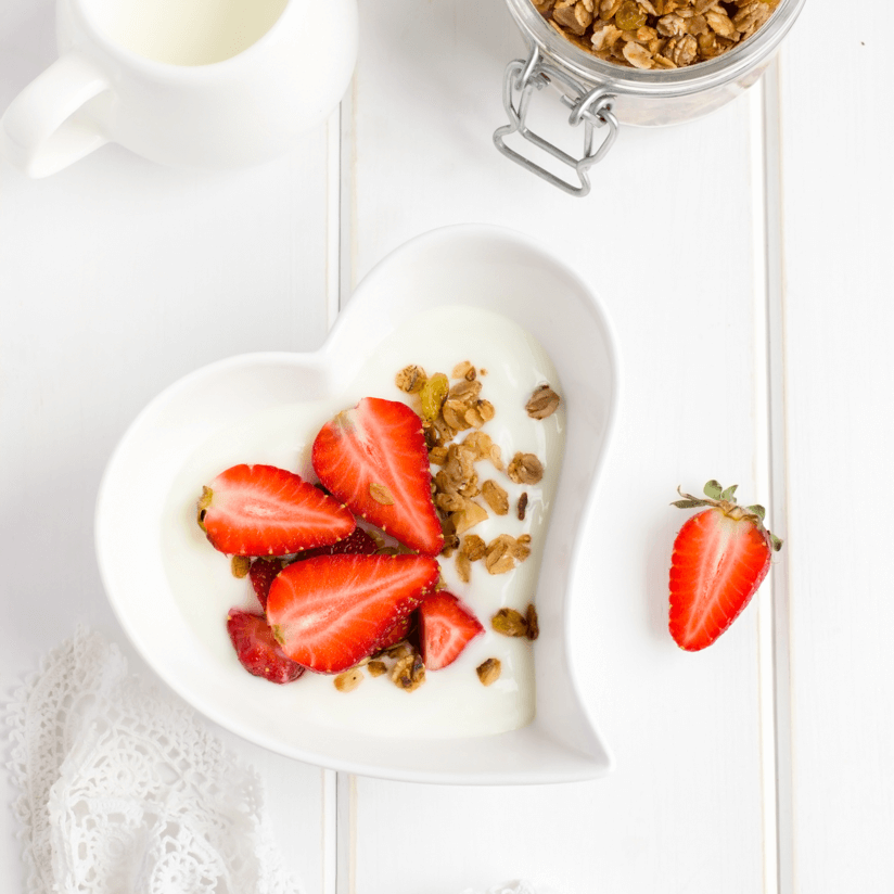 Yogurt with Granola and Strawberries in Heart Bowl