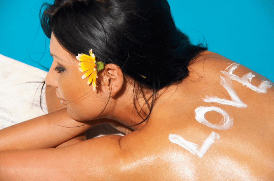 Love Written in Sunscreen on Woman's Back