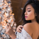 beautiful woman with christmas tree