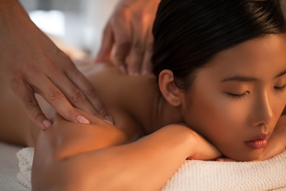 Woman getting a massage at a spa.