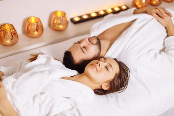 Couple on a spa tables together.