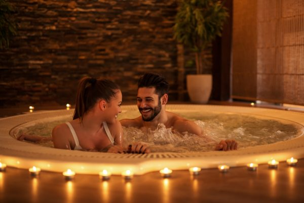Couple enjoying a couples spa bath.