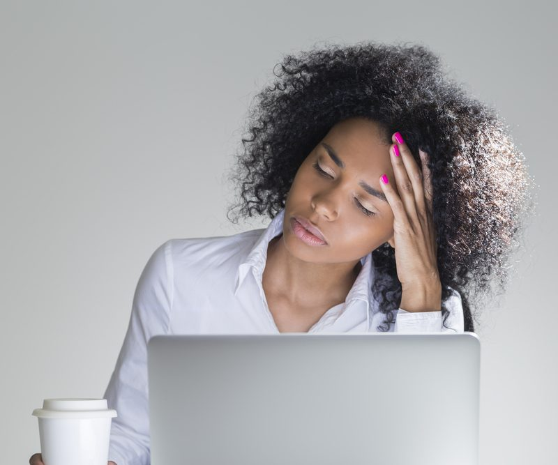 Woman infront of her laptop appears to be stressed out.