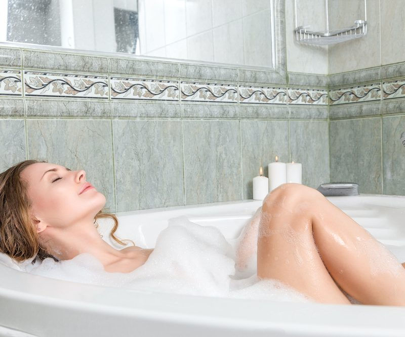 Woman relaxing in a bath tub.