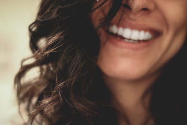 Close up of a woman's smile.
