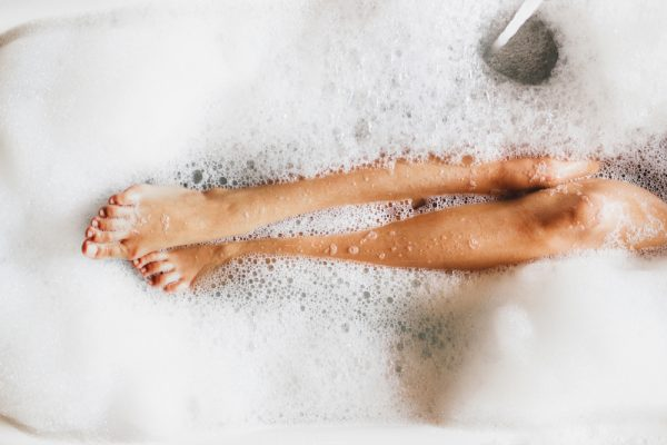 Legs of a woman in a bath.