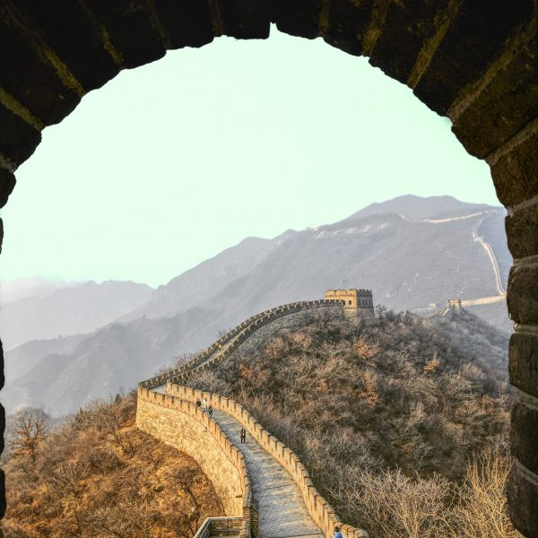 Depth perspective under an arc looking towards the moutains and path of the great wall of china to express depth in the ancient wisdom of Tao Te Ching.