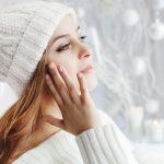 Women wearing winter clothing while wearing winter makeup.