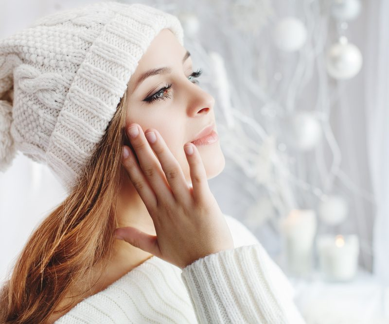 Women wearing winter clothing while wearing winter makeup.