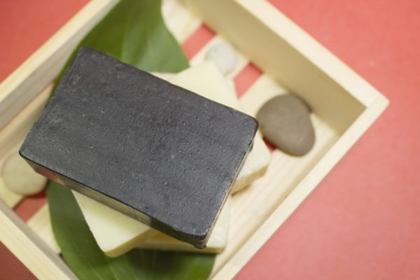 Charcoal soap amongst other soaps,  good travel friendly beauty carry-on essentials.