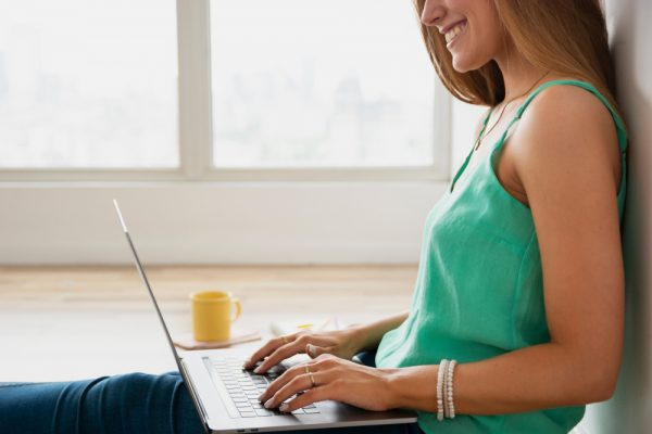 Woman taking in content online while practicing gratitude.