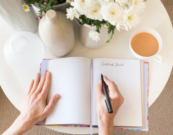 Writing into a journal daily can help with practicing gratitude.