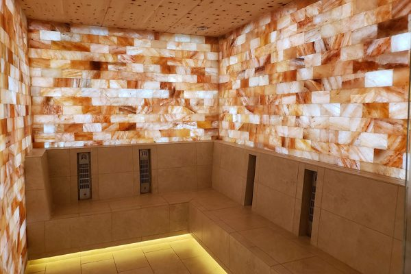 Strata Integrated Wellness Spa, an orange colored room at the Garden of Gods resort in Colorado.