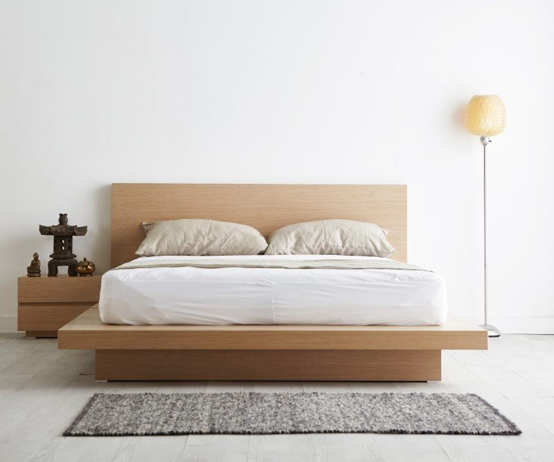 Minimalist bedroom - a bed, rug, lamp, and nightstand - learn how to declutter your space.