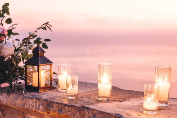 Candles lit outside on a stone wall - set the valentines day mood with a few candles.