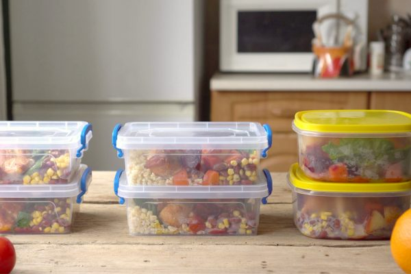 Food in storage in containers on a kitchen counter - meal prepping is a good way to switch up your morning routine.
