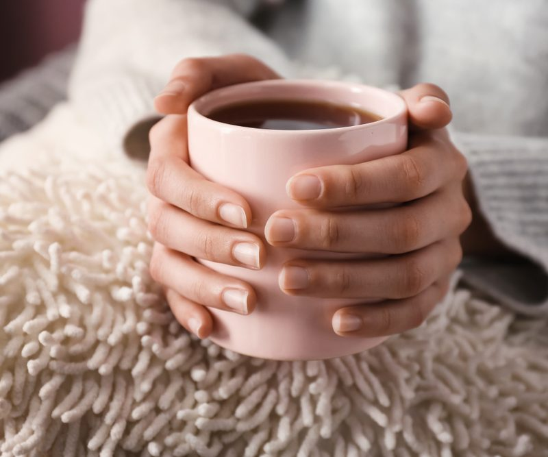 Holding a pink mug with tea in it - learn about our caffeine alternatives.