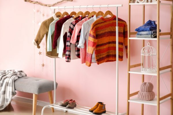 A clothes and shoe rack holding clothes and shoes - reorganize your home to kill time durring quarantine.