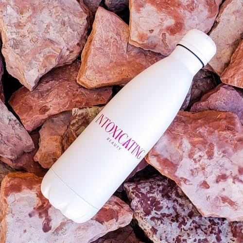 Intoxicating Beauty Water Bottle on Red Rocks