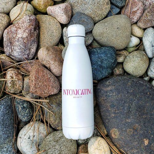 Intoxicating Beauty Water Bottle on Rocks