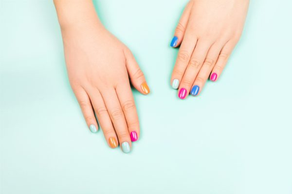 Woman with different colored nails - try a skittle nail pattern while no one is watching and see if it works for you!