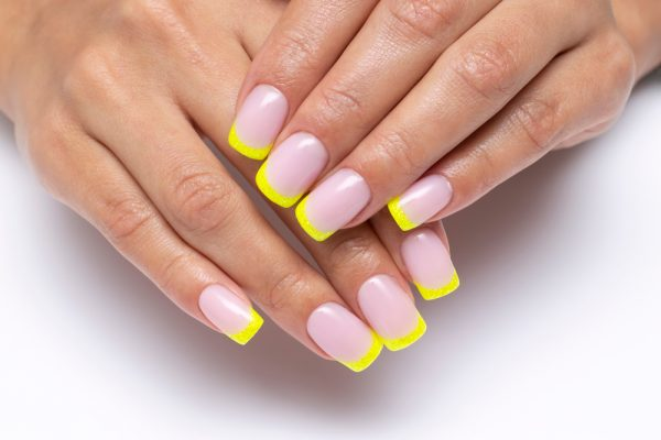 A manicure featuring colorful tips - just like a french manicure, but colorful tips uses a color other than white on the tip of the nail.