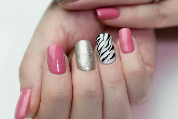 Showing off a manicure, pink, silver, and zebra nails - checkout animal print styles for your next nail pattern!