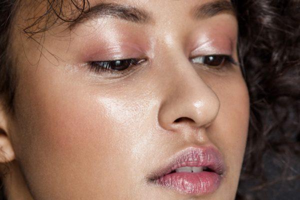 Closeup of woman with glowing dewy skin.