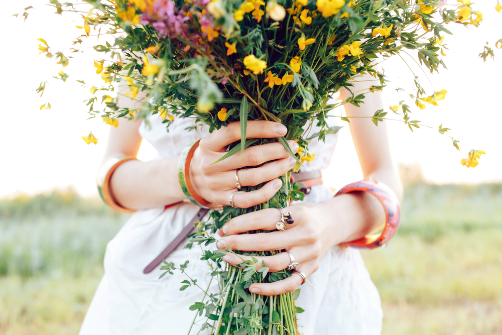 Woman holding a beautiful arrangement of flowers - here are some suggestions for flower retailers.