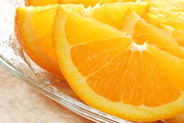 An orange cut into slices - a natural source of vitamin C