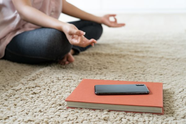 Meditating with phone face down, disconnecting from technology