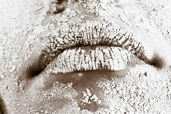 Face, mostly lips, covered in a white powder substance.