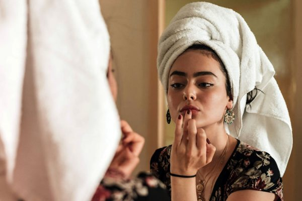 Woman getting her face ready for makeup