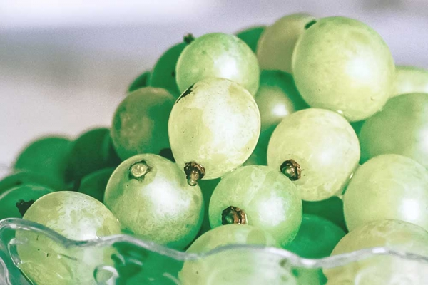 Green grapes in a glass bowl.