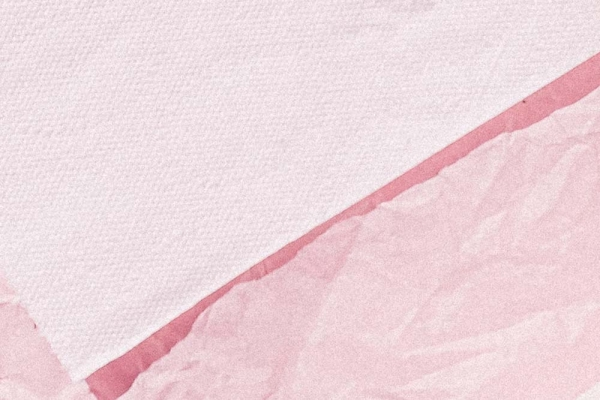 Tissue Paper on crumpled pink background.