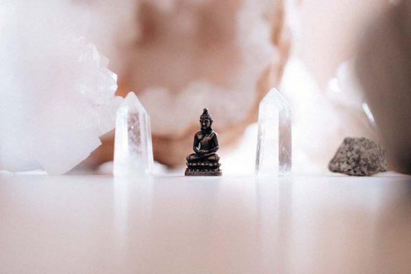 Buddha statue between crystals.